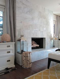 Fireplace Tiles - Design photos, ideas and inspiration. Amazing gallery of interior design and decorating ideas of Fireplace Tiles in bedrooms, living rooms by elite interior designers. Tiled Fireplace Wall, Fireplace Tile Surround, Home Fireplace, Fireplace Remodel, Marble Fireplaces, Fireplace Surrounds, Fireplace Design, Fireplace Modern, Fireplace Windows