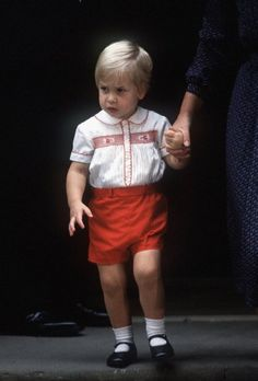 Prince William leaves St Mary's Hospital after visiting his newborn brother, Prince Harry, on September 16, 1984 in London, England. (Photo by Anwar Hussein/Getty Images)