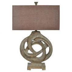 "Illuminate your living room or master suite in exotic style with this striking table lamp, showcasing a knot-inspired silhouette and linen shade.   Product: Table lampConstruction Material: Resin and linenColor: Chocolate and naturalFeatures: Openwork designAccommodates: (1) Bulb - not included Dimensions: 32"" H"