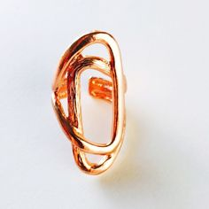 """Karine Sultan Rose Gold Jane Ring. The Rose Gold Jane ring by Karine Sultan is a celeb favorite. Gorgeous! Features a brushed geometric cut- out design. 24K Gold- Plated Pewter. 1"""" W x 1.5"""" H. Adjustable. Karine Sultan Jewelry Rings"""