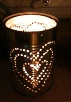 Paint tin can lantern 2 different colour inside and out and punch out stars and hearts, attach string handle