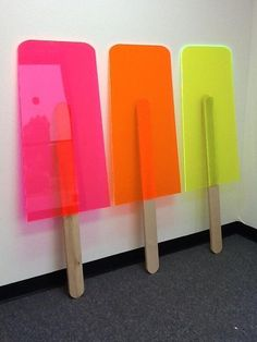 Signage or even an exhibition or event display make giant popsicles for summer party with neon acrylic and wood