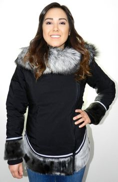 Mid-length form fitting parka with an amautik style sealskin hem that creates a time-less, feminine look. Features contrasting sealskin hem, hood with fox fur t