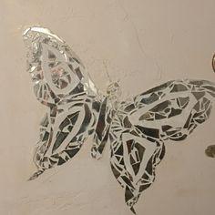 Broken mirror art butterfly on wall