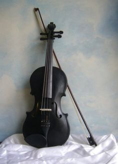 "Violin.   ""Such a singular violin, hewn out of the tombstone of its creator's grandfather, black as a moonless night sky; the Blackbird must be beloved among psychopomps wishing to soothe tormented souls."""