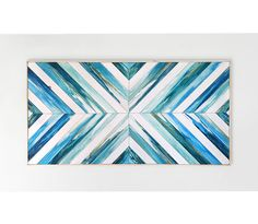 This coastal wood wall art has been intricately designed to accentuate a symmetrical pattern, and is perfect for any niche in your home. With a focus on individually hand painted pieces, this wood art has a natural feel with a relaxing beach vibe. Ethos Woodworks crafts each piece by