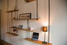Shelves suspended in solid oak and hemp rope. Dimensions to measure. The presented shelf measuring 2.50 metres wide.