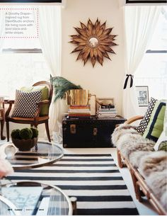 Anna Burke of Kemble Interiors chose a rug with wide black and white stripes for the living room of her Manhattan apartment. Image courtesy Lonny Magazine.