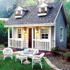 Tiny home, tiny home. Check out the porch on this garden shed. House plans available for this tiny home