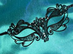 Intricate small/mid sized black, white, silver or gold (your choice) lightweight laser cut metal fretwork accented with clear gemstones for added glam and sparkle. **Like this mask but want it in another color? Sparkly white or silver perhaps? Convo me! I can make a custom mask for you.** Love this mask but want more bling? For $5 extra I can bedazzle around the eyes (https://www.etsy.com/listing/164470907/laser-cut-metal-mask-with-rhinestones?ref=shop_home_active) or for $15 extra I can…