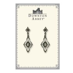 Indulge in rich raven hues with these black-toned drop earrings from our Downton Abbey® black Memento Collection. A bold hematite color centers a filigree motif which sweetly suspends from a decadent crystal-accented post. Comes in a Downton Abbey gift box. (Box color may vary.)