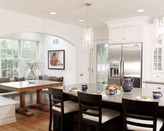 Contemporary white kitchen with inset cabinets.  For more inset cabinet ideas visit http://simplybeautifulkitchens.blogspot.ca/