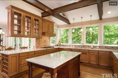 gorgeous kitchen, but also nice wood ceiling accents