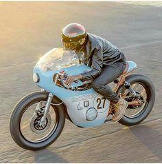 Amazing Café Racer underneath a racing cover.                                                                                                                                                                                 Más
