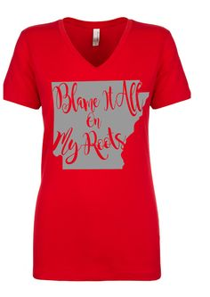 Blame it all on My Arkansas Roots Tshirt will help you show your Arkansas state pride no matter where you live or where you go. We Arkansas girls have to stick together. We are a special kind of Lady.   Ladies Ideal V‑Neck Tee Next level  Sizes  XS, S, M, L, XL, 2XL Features:   60% combed ringspun cotton, 40% polyester lightweight jersey  4 oz.  30 singles  Fabric laundered for reduced shrinkage  Front cover stitched 1x1 baby rib-knit set-in collar  Tear-away label  Measurements (in inches)…