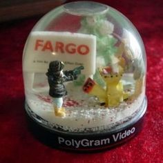 Fargo Snow Globe, Gael Grimsrud feeds Carl Showalter into the wood chipper while Mardge Gunderson pulls her gun. A promo to go with the tape release back in the days of VCRs.