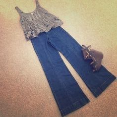 Free People wide leg jeans Amazing super stretchy wide leg, high waisted Free People jeans. Dark wash, interesting seaming and back slit pockets. Super 70's! Worn once! Free People Jeans Flare & Wide Leg