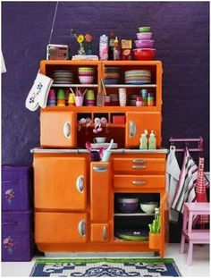 This room is so cheery!  Very BOLD!  I really love the orange cabinet ... has a retro vibe :)