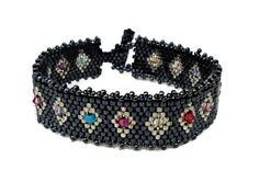 Black beaded bracelet with multicolored Swarovski elements.