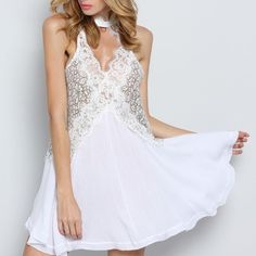 High-neck lace tunic Excellent condition. Sheer. Like a sleeveless version of the Secret Origins lace tunic! Dresses