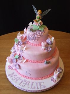 https://flic.kr/p/8BSJTg   Tinkerbell Birthday Cake #2   This was my second Tinkerbell cake and I like each one to look a little different.  The topper was a different one to the previous cake and I sat her on a flower with lots of blossoms, butterflies and toadstools.  The two little mice were my hubby's idea and I must admit that they looked perfect!