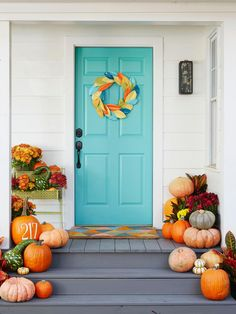 turquoise front door decorated for fall