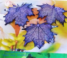 Real leaves taken to the next level. Silver maples, purple blue patina..special $18.95, via Etsy.