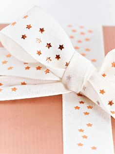 Crafted from rich cream satin with a copper foiled starry pattern, our fabulous ribbon will add a touch of luxury to your gift wrap. Designed to go perfectly with our Copper Wrapping Paper, it also sits beautifully agains plain kraft paper.