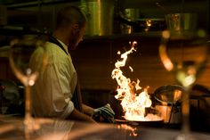 Stock Photo : Chef cooking with fire in frying pan