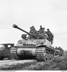 Unidentified troops of 3rd Battalion, The Royal Australian Regiment (3RAR), mounted on US tanks and trucks, take up their position in the vanguard of the United Nations Forces in Korea.  The tank ...