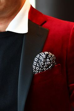 the devil in the details. Stunning red jacket with black contrast lapel. match that back with a white shirt black knit and gorgeous black and white patterned silk pocket square.