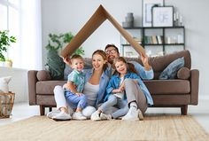 concept of housing and relocation. happy family mother father and kids with roof at a home Moving And Storage, Inspirations Magazine, Buying A New Home, Home Ownership, Mother And Father, Second Child, Home Photo, Happy Family, House Prices