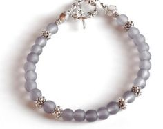 Check out GRAY Women's stackable bracelet, stacking bracelet, statement bracelet, beaded bracelet on dunglebees