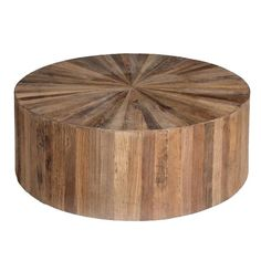 $997 The circular Cyrano coffee table is inlaid with triangular offset pieces of recycled elm wood. Simple in form but bold in design, the table is slightly elevated off the floor for added mobility and finished with a water based sealer.    Materials:  Recycled Elm  Finish:  Natural Elm