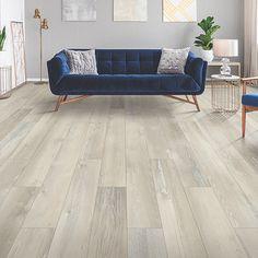White, medium wood-look flooring. Pergo Extreme Wood Originals in Blanched Pine