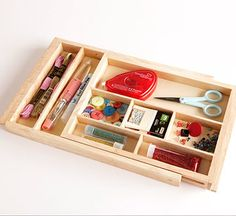 Before: Jewelry Drawer Organizer    In the bedroom, this wooden organizer holds earrings, bracelets, and necklaces. In the crafts room, it organizes small supplies ----------------------------------------------------------------------  After: Embellishment Organizer  This expandable tray is a great solution for storing tiny, easily misplaced items such as eyelets or brads in your crafts room.