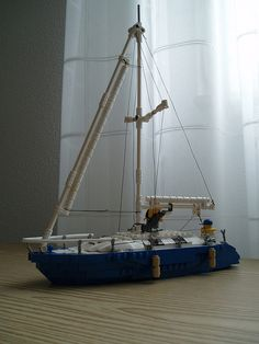 I may have a Coast Guard helicopter and a Coast Guard boat, but who are they going to save? I felt I needed another boat. The picture is a bit dark, but then again, so is the weather. Lego Tree House, Lego Boat, Lego Truck, Gamer Setup, Micro Lego, Lego Ship, Cool Lego Creations, Building Systems, Lego Models
