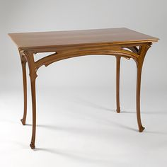 I want a dining table similar to this art nouveau writing table.