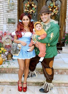 """Nicole """"Snooki"""" Polizzi, her fiance Jionni LaValle and baby Lorenzo, 14 months, dressed as characters from The Wizard of Oz for Halloween."""