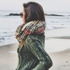 Green sweater and plaid scarf