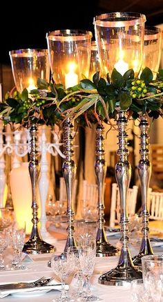 candles with glass & greenery for formal table setting