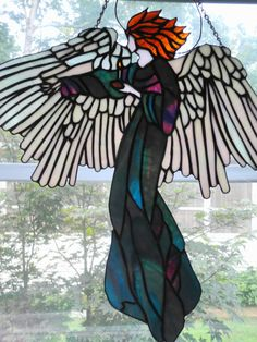 Stained Glass  Angel. $185.00, via Etsy.