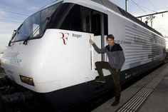 Roger Federer with the train named after him.