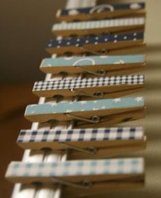 Mini clothes pins covered in Scrapbook paper