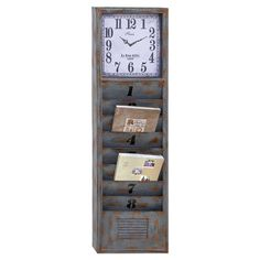 Bring eye-catching style to your decor with this stately metal wall clock, showcasing a weathered finish and 8 conevenient cubbies for mail and magazines.  ...