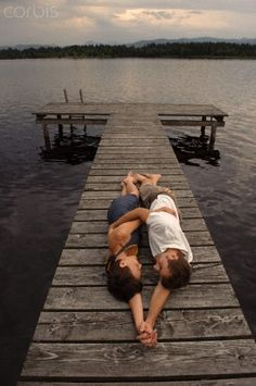 Cute couple shot  Could make it the Save The Date photo on the rest of the dock