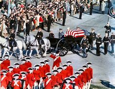 11/25/63: The funeral procession enters Arlington Cemetery, where a fife and drum corps stand at attention.