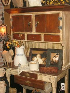 ARMOIRES, BOOKSHELVES, AND DISPLAY CABINETS ARE JUST A FEW PIECES THAT CAN ADD TO PRIMITIVE DECOR.