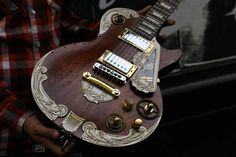 I've seen some pretty ugly steampunked guitars in my day, but this isn't one of them. This one's about as beautiful as they get. French company Wild Customs made this Gibson LesPaul into a steampunk masterpiece.    Check out some of these photos: