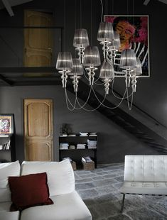 """Gadora Chic 6+3 chandelier. The elements in painted blown glass or """"rigadin"""" in the normal version, are combined with the handmade shades in class 1 fire-proof organdie, available in 6 different colors. They are suspended as something ethereal and they give a sensation of lightness to your spaces."""